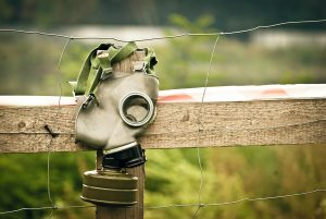 gas mask on fence to help vegans fight air pollution
