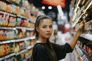 woman browsing free from aisle in supermarket