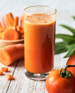 vegan carrot and tomato juice in glass