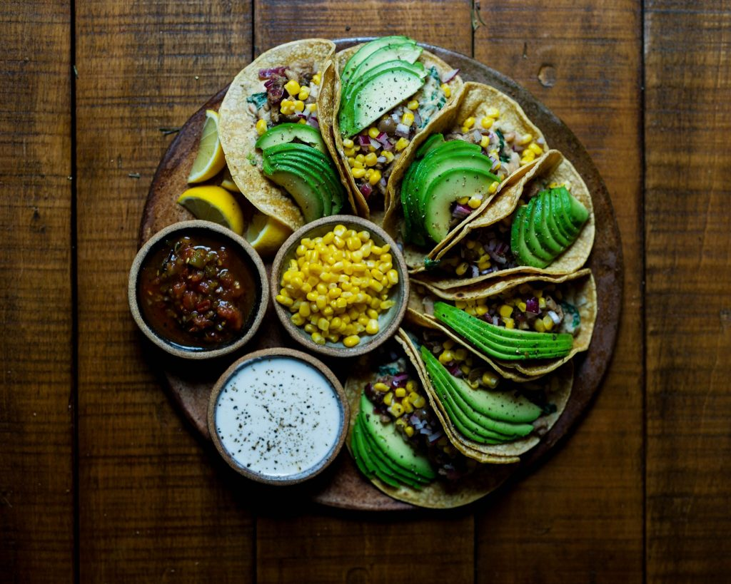 vegan tacos with avocado and dips